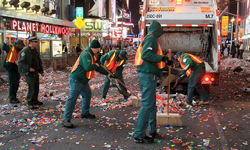 Street sweepers clean up after New Year's ball drop