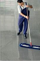 Dust mopping a large commercial facility.