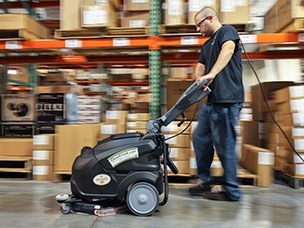 Scrubbing floor with auto scrubber